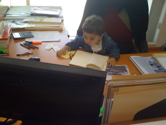 A pic of my son at my desk while I was still working as an architect.